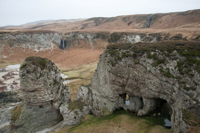 Waterfalls and natural arches south of Bolsa, Islay