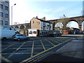 SJ8990 : Railway viaduct and Pineapple Inn, Stockport by Peter Barr