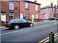 SJ9594 : Lollipop Lady on Dowson Road by Gerald England