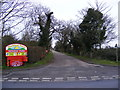 TM5287 : Cliff Farm Lane & entrance to Heathland Caravan Park by Adrian Cable