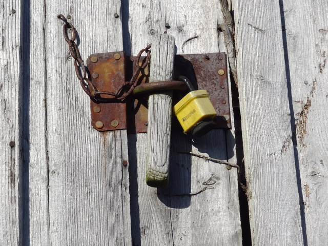 Padlock and chain on an old shed