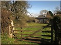 SX8765 : Gate and outbuilding, South Whilborough by Derek Harper