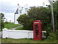 NG3042 : Caroy: telephone box on the A863 by Chris Downer