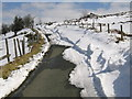 SO3496 : Snow blocked road near the Stiperstones by Dave Croker