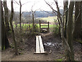 TQ3827 : Footpath leaving Sandpits Woods by Stephen Craven