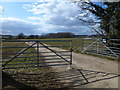 TF0603 : Gates at Mill Farm near Wittering by Richard Humphrey