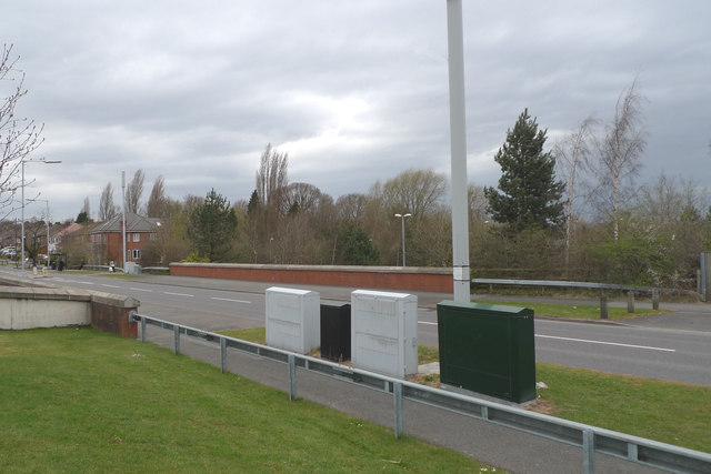 Four telecom cabinets beside Etchells Road