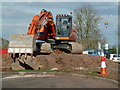 SO8754 : Worcestershire Royal Hospital - big orange digger  by Chris Allen