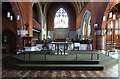 TQ2470 : St Andrew, Herbert Road - Nave altar by John Salmon