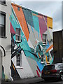 TQ3375 : Painted building on Crawthew Grove by Andrew Wilson