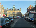 SP6948 : Watling Street passes Towcester Town Hall by Stuart Logan