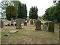 SJ4570 : Graves in Plemstall churchyard by Richard Law
