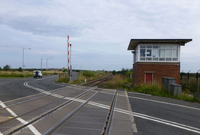 Signal box beside level crossing