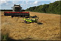 TL0341 : Arable field with harvester by Philip Jeffrey