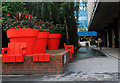 TQ3381 : Seat and giant planters, Aldgate by Julian Osley