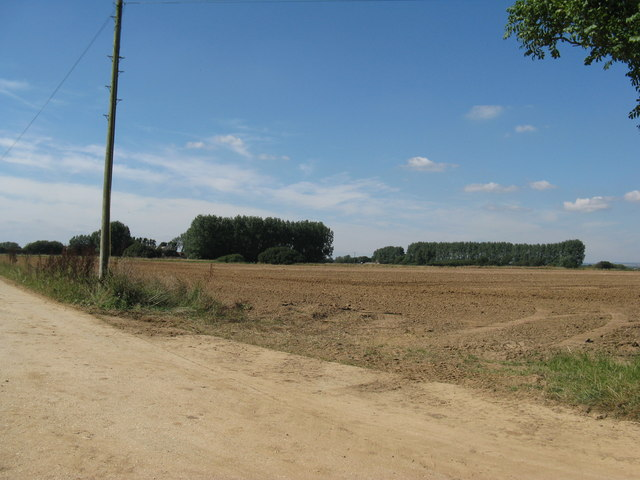 Recently ploughed field by footpath 101