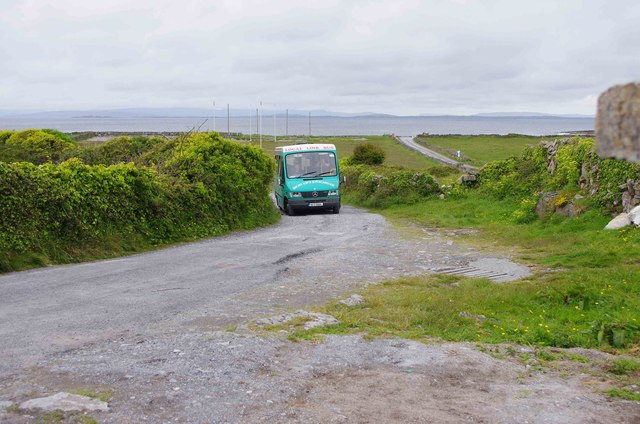 Minibus approaching Na Seacht dTeampaill (Seven Churches), near Onaght, Inishmór (Árainn), Aran Islands, Co. Galway