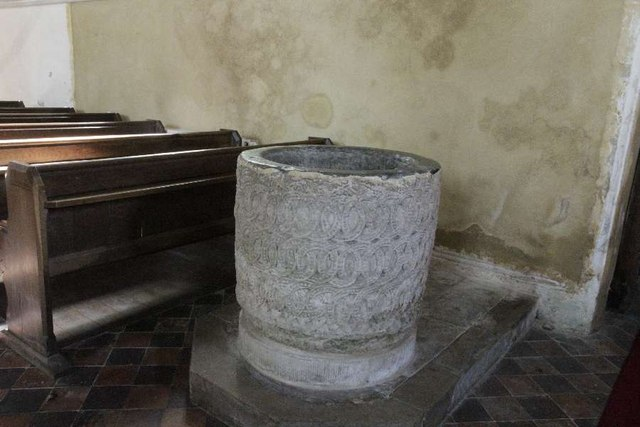 Stone font by the door