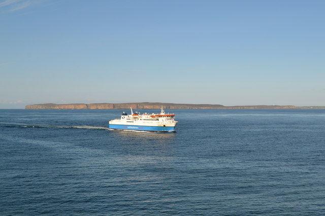 Clardon Head and MV Hamnavoe, viewed from Scrabster Harbour