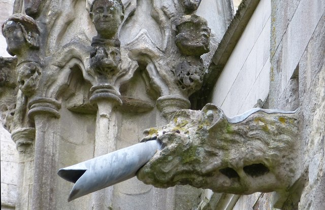 Gargoyle and heads, Chichester Cathedral