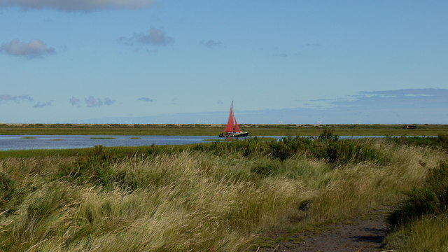 Red sail on Cley Channel