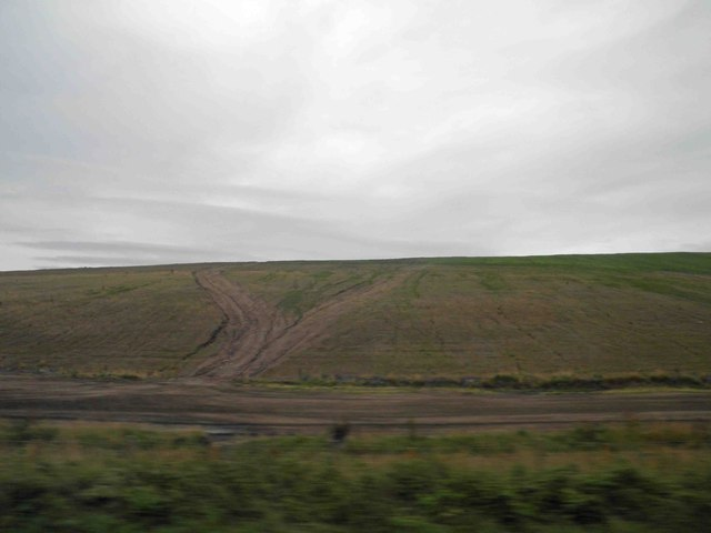 What looks like a landfill site in former opencast workings alongside the East Coast main railway line