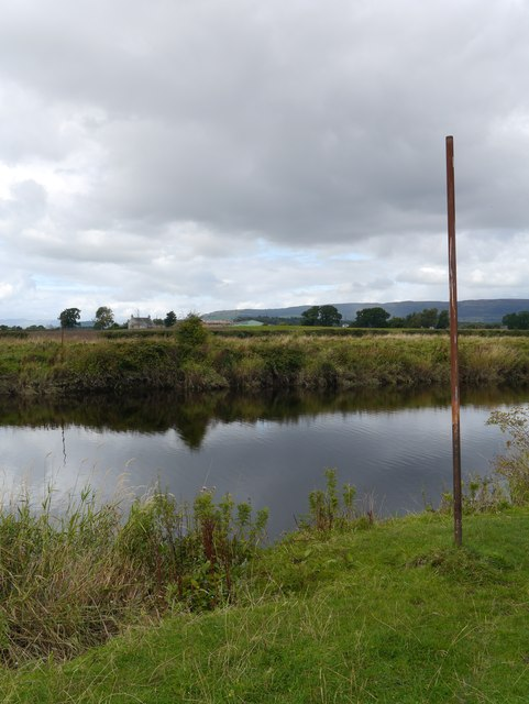 Poles By The Black Cart Water