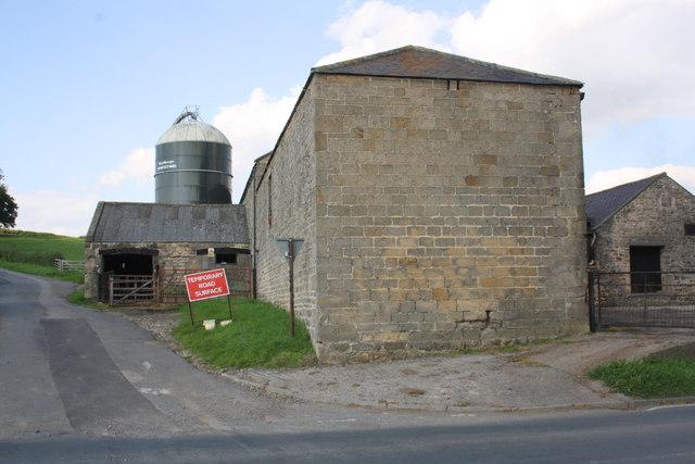 Buildings of Akebar Farm at crossroads