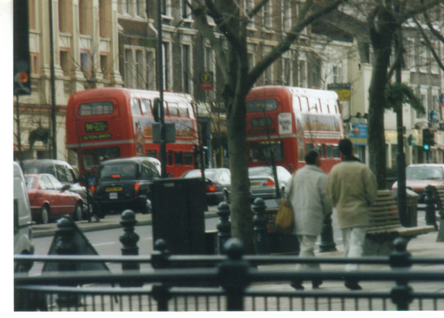 A pair of 94 Routemasters on Notting Hill Gate, 2002