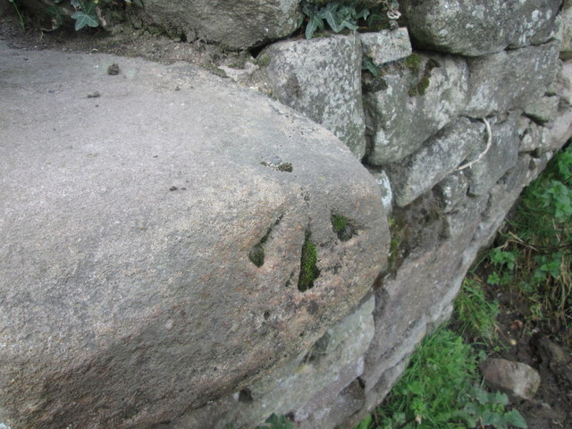 Rivet benchmark on a stile beside Whitewells lane