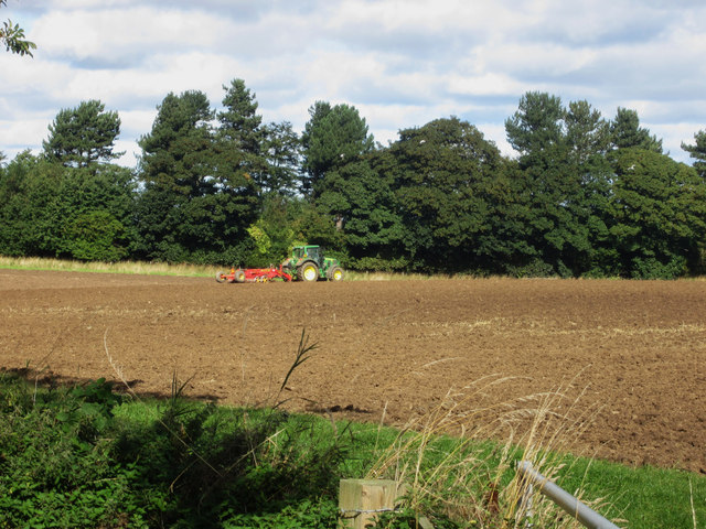 Tractor and press working at Easington Demesne