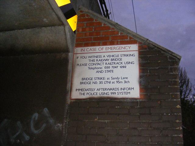 Sign on the Sandy Lane Railway Bridge