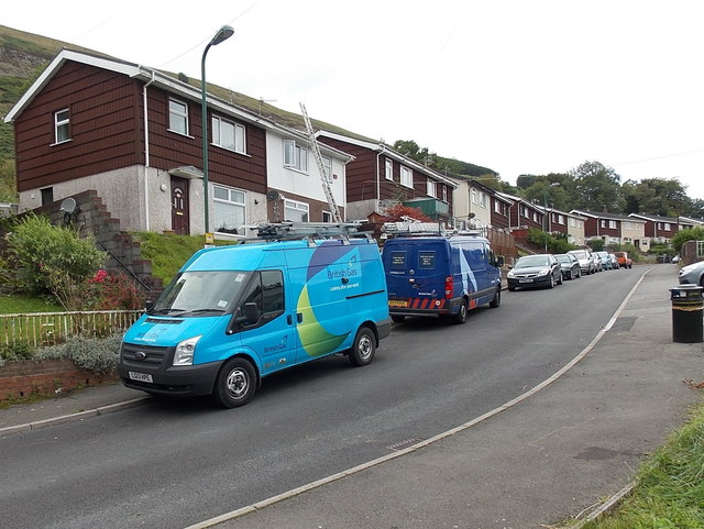 Old-style and a new-style British Gas vans in Blaina