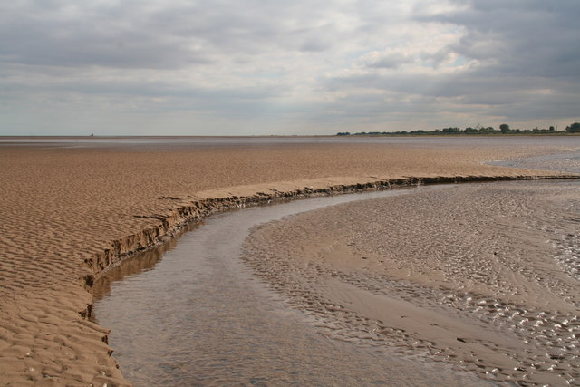 Watercourse through the sand at low tide