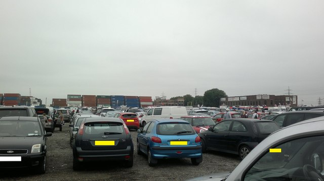 View of containers in Bullmans Self Storage and the Dagenham Market building from the car park