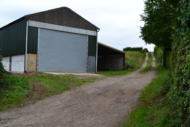 Farm building beside steep track