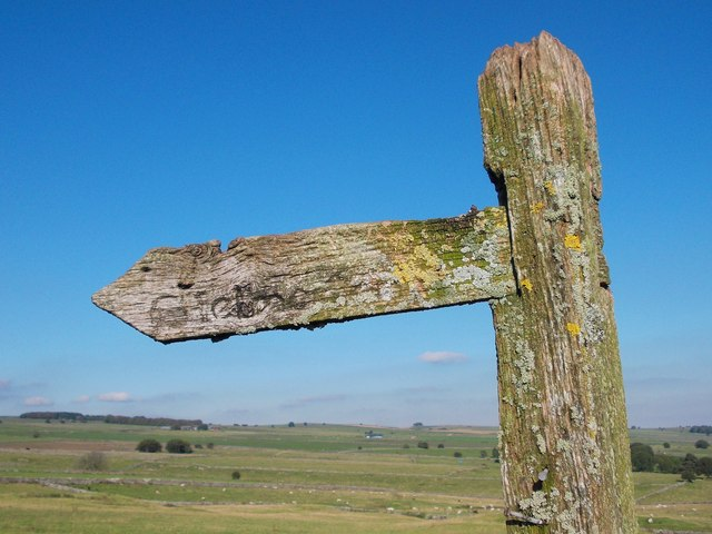 Limestone uplands and a weathered signpost
