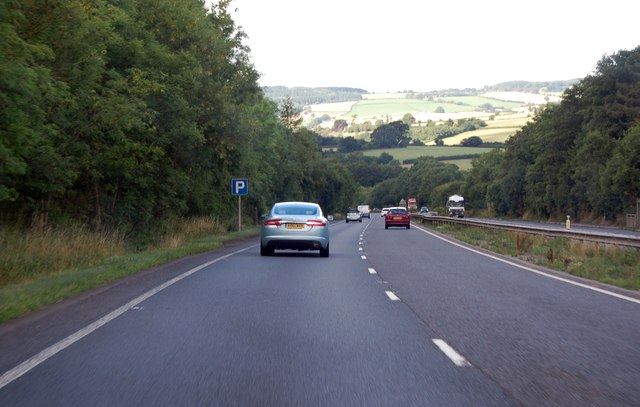 A40 runs downhill by a parking area