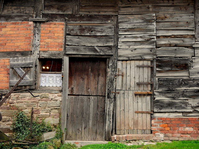 Barn wall; brick and timber patchwork
