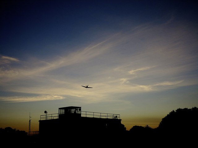 A Memorial Flight Spitfire approaching the Lincolnshire Aviation Heritage Centre Control Tower