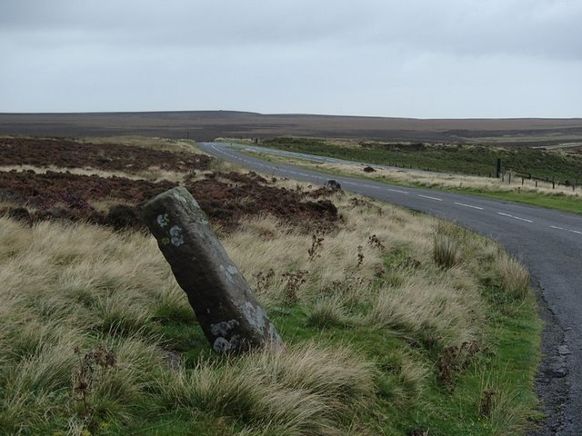 Stone pillar and moorland lane