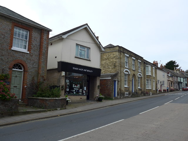 Looking across the High Street towards a hairdressers