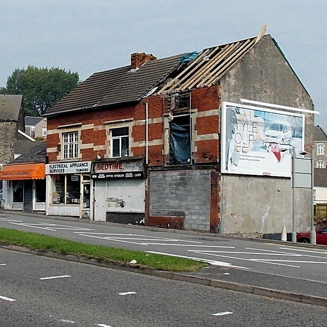 Derelict building at the end of a row of shops in Carmarthen Road Swansea