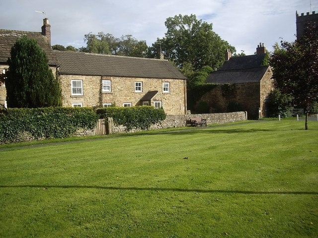 Stone built houses on village green (east)