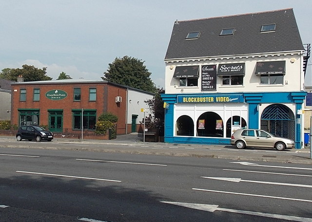 Hairdressers shop above an empty Blockbuster Video Express in Fforestfach Swansea
