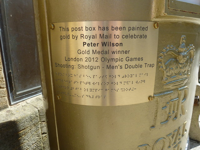 Inscription on the golden postbox in Cheap Street
