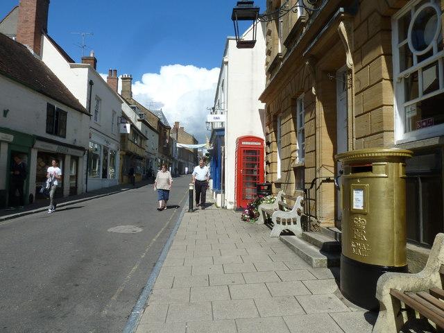 Approaching a golden postbox in Cheap Street