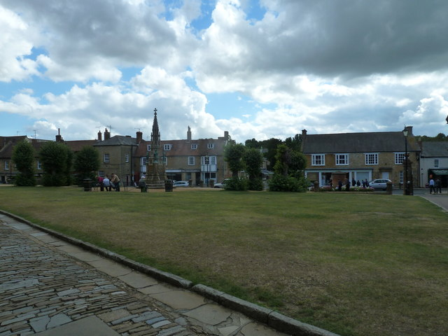 Looking from the abbey across a green