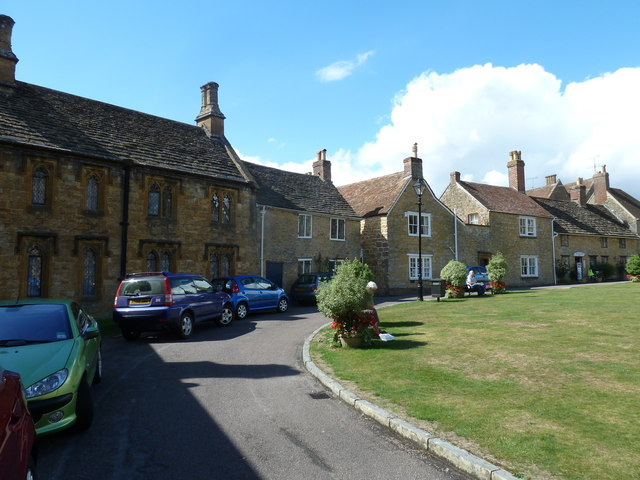 Houses on  a green opposite Sherborne Abbey