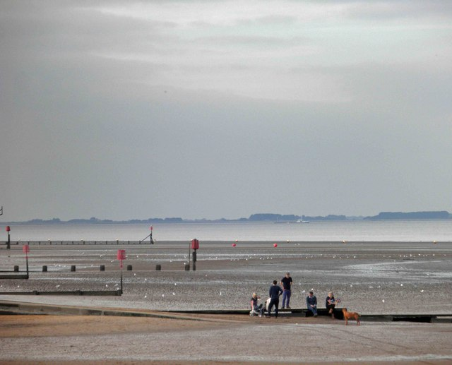 People on Brighton slipway, Cleethorpes with the River Humber looking misty